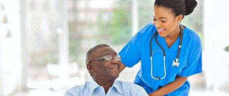 a nurse looking at an elderly