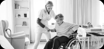a nurse helping an elderly on a wheelchair
